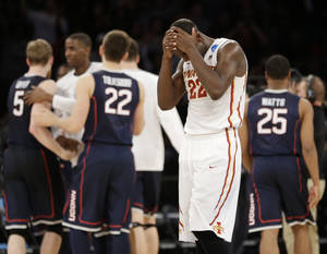 Photo - Iowa State's Dustin Hogue reacts after his team lost 81-76 to Connecticut in a regional semifinal of the NCAA men's college basketball tournament Friday, March 28, 2014, in New York. (AP Photo/Seth Wenig)