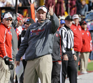 Photo - Nebraska head coach Bo Pelini disagrees with a call during the fourth quarter of an NCAA college football game against Minnesota in Minneapolis Saturday, Oct. 26, 2013. Minnesota beat Nebraska 34-23. (AP Photo/Ann Heisenfelt)