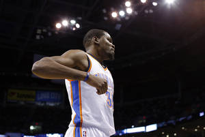 Photo - Oklahoma City's Kevin Durant (35) reacts to a play during the NBA game between the Oklahoma City Thunder and the Sacramento Kings at the Chesapeake Energy Arena, Sunday, Jan. 19, 2014.  Photo by Sarah Phipps, The Oklahoman