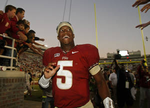Photo - Florida State quarterback Jameis Winston (5) reacts to fans as he leaves Doak Campbell stadium after an NCAA college football game against North Carolina State, Saturday, Oct. 26, 2013, in Tallahassee, Fla. Florida State won 49-17. (AP Photo/Phil Sears)