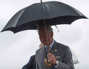 Photo - Prince Charles arrives in the rain at a Canadian Forces Base airport in Winnipeg, Canada, May 20, 2014 (AP Photo/The Canadian Press, David Lipnowski)