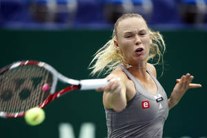 Photo -   Denmark's Caroline Wozniacki returns a ball to Sweden's Sofia Arvidsson during a semifinal match at the Kremlin Cup tennis tournament in Moscow, Russia, Saturday, Oct. 20, 2012. (AP Photo/Misha Japaridze)