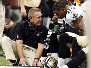 Photo -   New Orleans Saints defensive coordinator Steve Spagnuolo talks to cornerback Corey White (24) in the second half of an NFL football game against the Kansas City Chiefs in New Orleans, Sunday, Sept. 23, 2012. (AP Photo/Jonathan Bachman)