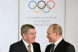 Photo - IOC President Thomas Bach, left, welcomes Russian President Vladimir Putin before the IOC President?'s Gala Dinner on the eve of the opening ceremony of the 2014 Winter Olympics, Thursday, Feb. 6, 2014, in Sochi, Russia.  (AP Photo/Andrej Isakovic, Pool)