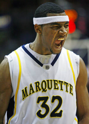 Photo - Marquette's Lazar Hayward reacts after the shot clock ran out on Villanova late in the second half of a basketball game Monday Feb. 19, 2007 in Milwaukee. (AP Photo/Darren  Hauck) ORG XMIT: WIDH103