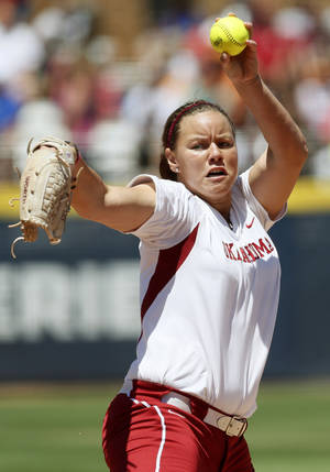 Photo - Keilani Ricketts (10) pitches for OU during an NCAA softball game in the Women's College World Series between Oklahoma and Texas at ASA Hall of Fame Stadium in Oklahoma City, Saturday, June 1, 2013. Oklahoma won 10-2 in five innings. Photo by Nate Billings, The Oklahoman