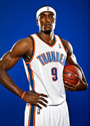 Photo - SERGE IBAKA poses for a photo during the Oklahoma City Thunder media day on Monday, Sept. 27, 2010, in Oklahoma City, Okla.   Photo by Chris Landsberger, The Oklahoman