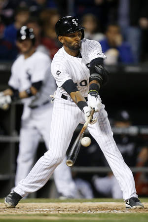 Photo - Chicago White Sox's Alexei Ramirez connects for an RBI-single against the Cleveland Indians during the seventh inning of a baseball game on Friday, April 11, 2014, in Chicago. (AP Photo/Andrew A. Nelles)
