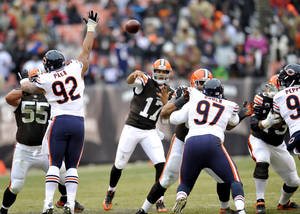 Photo - Cleveland Browns quarterback Jason Campbell (17) passes against the Chicago Bears in the third quarter of an NFL football game, Sunday, Dec. 15, 2013, in Cleveland. (AP Photo/David Richard)