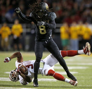 Photo - Baylor's K.J. Morton (8) hits Oklahoma's Sterling Shepard (3) during an NCAA college football game between the University of Oklahoman (OU) Sooners and the Baylor Bears at Floyd Casey Stadium in Waco, Texas, Thursday, Nov. 7, 2013. Photo by Bryan Terry, The Oklahoman