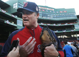 Photo - Boston Red Sox manager John Farrell speaks to a reporter during team baseball practice in at Fenway Park in Boston, Monday, Oct. 21, 2013. the Red Sox are preparing for Game 1 of the World Series against the St. Louis Cardinals on Wednesday. (AP Photo/Elise Amendola)