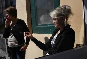 photo - In this Thursday, Sept. 6, 2012 file photo two women smoke at a downtown street in the eastern Russian city of Vladivostok, where the Asia-Pacific Economic Cooperation summit is taking place. (AP Photo/Vincent Yu, file) 