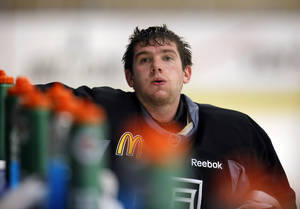 photo - Los Angeles Kings goalie Jonathan Quick takes a short break during NHL hockey practice in El Segundo, Calif., Friday, Jan. 18, 2013. The Kings will host the Chicago Blackhawks in the season opener on Saturday. With 48 games crammed into roughly three months recovery time will be at a premium. Goaltenders use to playing every minute of every game will have to pace themselves, maybe even take some extra nights off, to stay fresh. (AP Photo/Jae C. Hong)