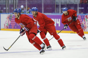 Photo - Czech Republic forward Roman Cervenka, forward Petr Nedved and forward Jiri Novotny race around the rink during a training session at the Bolshoy Ice Dome at the the 2014 Winter Olympics, Sunday, Feb. 9, 2014, in Sochi, Russia. (AP Photo/Mark Humphrey)