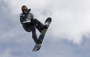 Shaun White flies off a jump during the World Cup U.S. Grand Prix snowboarding qualifications, Thursday, Dec. 19, 2013, in Frisco, Colo. (AP Photo/Julie Jacobson)