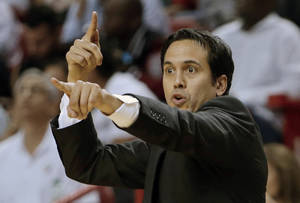 Photo - Miami Heat head coach Erik Spoelstra calls out a play during the first half of Game 1 of the NBA basketball playoff series in the Eastern Conference semifinals against the Chicago Bulls, Monday, May 6, 2013 in Miami. (AP Photo/Lynne Sladky)