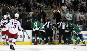 Photo - Columbus Blue Jackets and Dallas Stars players rush to the bench in the first period of an NHL Hockey game Monday, March 10, 2014, in Dallas. Stars center Rich Peverly was transported to the hospital after play was suspended. (AP Photo/Sharon Ellman)