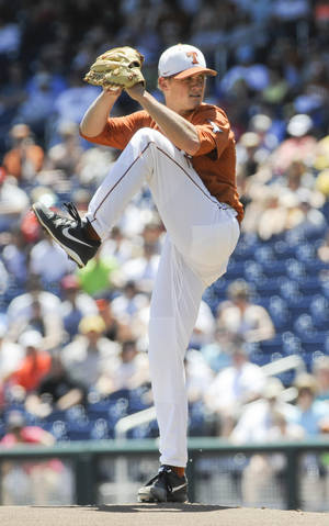 Photo - Texas starting pitcher Nathan Thornhill works against Vanderbilt in the first inning of an NCAA College World Series baseball game in Omaha, Neb., Friday, June 20, 2014. (AP Photo/Eric Francis)