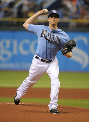 Photo -   Tampa Bay Rays starting pitcher Jeremy Hellickson delivers to the New York Yankees during the first inning of a baseball game Sunday, April 8, 2012, in St. Petersburg, Fla. (AP Photo/Brian Blanco)