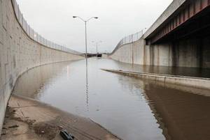 Photo - The westbound off-ramp and eastbound on-ramp to I-44 were closed at Classen Boulevard due to flooding from weekend rains in Oklahoma City Monday  <strong>PAUL B. SOUTHERLAND - PAUL B. SOUTHERLAND</strong>