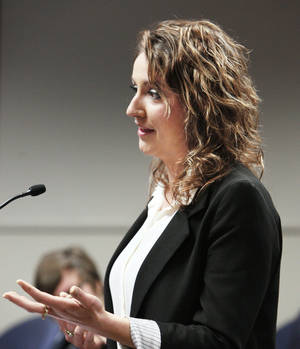Photo - University of Central Oklahoma senior Sarah Mashburn addresses the Oklahoma Regents for Higher Education during a public hearing on college tuition and fees Thursday in Oklahoma City.  Photos by Paul B. Southerland, The Oklahoman