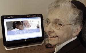 photo -   In this April 10, 2012, photo, sister Elaine Lachance works at a computer displaying a photo from the St. Joseph convent on it, in Biddeford, Maine. Good Shepherd Sisters of Quebec has just six convents in Maine and Massachusetts with fewer than 60 sisters. The youngest is 64, and it's been more than 20 years since a new member has joined. Sister Lachance is using the Internet, social media and even a blog to attract women who feel the calling to serve God. (AP Photo/Pat Wellenbach)