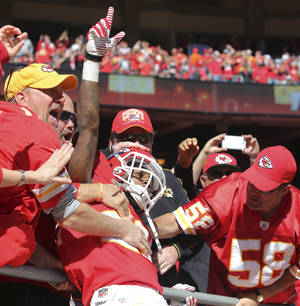Photo - Kansas City Chiefs wide receiver Dexter McCluster (22) celebrates his touchdown with fans during the first half of an NFL football game against the Cleveland Browns in Kansas City, Mo., Sunday, Oct. 27, 2013. (AP Photo/Ed Zurga)