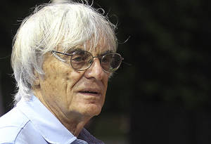 Photo - Formula One chief Bernie Ecclestone stands at the pit building ahead of Sunday's Singapore Formula One Grand Prix on Thursday, Sept. 19, 2013, in Singapore. (AP Photo/Wong Maye-E)