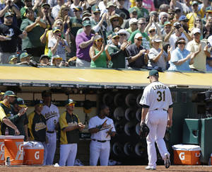 Photo - Oakland Athletics' Jon Lester (31) receives a standing ovation from fans as he leaves the baseball game against the Kansas City Royals in the seventh inning  Saturday, Aug. 2, 2014, in Oakland, Calif. (AP Photo/Ben Margot)