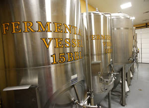 photo - The brewhouse at OKCity Brewing Co. features a series of stainless steel fermenters and brew kettles.