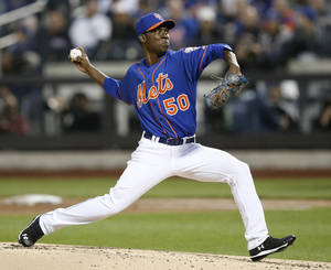 Photo - New York Mets starting pitcher Rafael Montero (50) delivers in the second inning against the New York Yankees in a baseball game in New York, Wednesday, May 14, 2014. (AP Photo/)