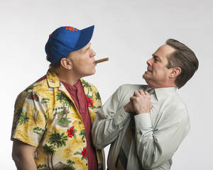 "Photo - Jonathan Beck Reed, left, as  Oscar Madison, and Martin Burke as Felix Ungar head the cast of the Lyric Theatre production of Neil Simon's ""The Odd Couple.""   <strong>Photos by Keith Rinearson - Photos by Keith Rinearson</strong>"