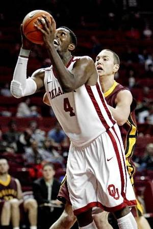 Photo - Andrew Fitzgerald (4) shoots guarded by Marko Filipovic (20) during the first half of the college basketball game between the University of Oklahoma (OU) Sooners and Northern State Wolves at the Lloyd Noble Center in Norman, Okla., Tuesday, November 2, 2010. Photo by Steve Sisney, The Oklahoman.