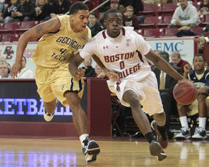 Photo - Chestnut Hill,  MA      1/8/11      Boston College Reggie Jackson drives to the basket with pressure from Georgia Tech Glen Rice Jr. during 1st half action at the Conte Forum on Saturday  January  8,  2011..  slug:   09bcgt Section:  sports   reporter:    (Photo by Matthew J. Lee, Boston Globe