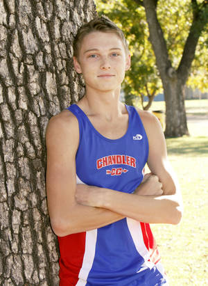 Photo - Chandler cross country runner Chris Lowery poses at a park in Chandler, OK, Thursday, Oct. 20, 2011. By Paul Hellstern, The Oklahoman ORG XMIT: KOD