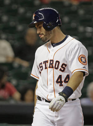 Photo - Houston Astros' Matt Pagnozzi heads back to the dugout after striking out against the Cincinnati Reds in the ninth inning of a baseball game Tuesday, Sept. 17, 2013, in Houston. The Reds won 10-0. AP Photo/Pat Sullivan)