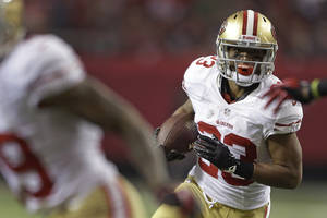 photo - San Francisco 49ers running back LaMichael James carries the ball during the first half of the NFL football NFC Championship game against the Atlanta Falcons Sunday, Jan. 20, 2013, in Atlanta. (AP Photo/David Goldman)
