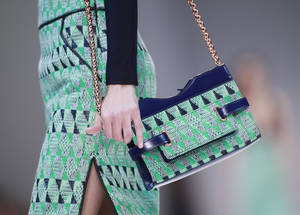 photo -   A model shows a handbag by French-Swedish fashion designer Marcel Marongiu for Guy Laroche's ready to wear Spring-Summer 2013 collection, and presented in Paris, Wednesday, Sept.26, 2012. (AP Photo/Thibault Camus)