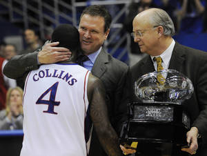Photo -  In this photo from 2010, Big 12 Associate Commisioner John Underwood, right prepares to hand the Big 12 Championship trophy to Kansas coach Bill Self and Sheron Collins. AP ARCHIVE PHOTO  <strong>Reed Hoffmann -   </strong>
