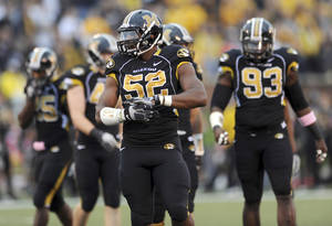 "Photo - FILE - In this Sept. 17, 2011, file photo, Missouri defensive lineman Michael Sam takes up his position during the first quarter of an NCAA college football game against the Western Illinois in Columbia, Mo. But since the Missouri All-American defensive end said he was an ""openly, proud gay man,"" college athletic directors and coaches have been forced to review protocols on their campuses. (AP Photo/L.G. Patterson, File)"