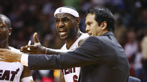 Photo - Miami Heat coach Erik Spoelstra, right, and LeBron James protest a loose ball foul called against James during the second half of an NBA basketball game against the Los Angeles Clippers in Miami, Thursday, Nov. 7, 2013. The Heat won 102-97. (AP Photo/J Pat Carter)