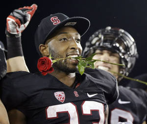 photo - Stanford 's Stepfan Taylor (33) celebrates after a 27-24 win over UCLA during the Pac-12 championship NCAA college football game in Stanford, Calif., Friday, Nov. 30, 2012. The Cardinal (11-2) will play the winner of the Big Ten title game between Nebraska and Wisconsin in the Rose Bowl on Jan. 1. (AP Photo/Marcio Jose Sanchez)