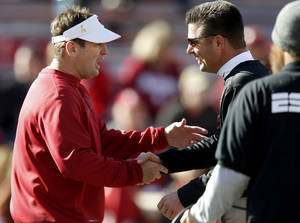 photo - Oklahoma State coach Mike Gundy and Oklahoma coach Bob Stoops talk prior to the Bedlam college football game between the University of Oklahoma Sooners (OU) and the Oklahoma State University Cowboys (OSU) at Gaylord Family-Oklahoma Memorial Stadium in Norman, Okla., Saturday, Nov. 24, 2012. Photo by Bryan Terry, The Oklahoman