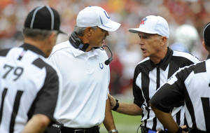Photo -   Indianapolis Colts coach Chuck Pagano, center left, talk with referee Jerry Hughes, right, during the first half of an NFL preseason football game against the Washington Redskins on Saturday, Aug. 25, 2012, in Landover, Md. (AP Photo/Richard Lipski)