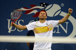 Photo -   Mardy Fish celebrates his victory over Gilles Simon of France in the third round of play at the 2012 US Open tennis tournament, Saturday, Sept. 1, 2012, in New York. (AP Photo/Henny Ray Abrams)