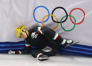 Photo - Arianna Fontana of Italy crashes out in a women's 1000m short track speedskating quarterfinal at the Iceberg Skating Palace during the 2014 Winter Olympics, Friday, Feb. 21, 2014, in Sochi, Russia. (AP Photo/Vadim Ghirda)