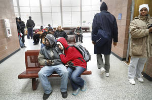 Photo - Bus riders at the  MetroTransit Center, 420 NW 5th St., on Monday, Dec 23, 2013.   Photo by Jim Beckel, The Oklahoman