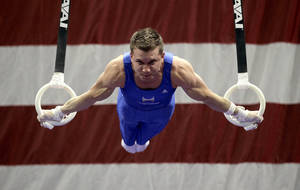 Photo - Jonathan Horton competes in rings during the men's senior division at the U.S. gymnastics championships, Saturday, June 9, 2012, in St. Louis. (AP Photo/Jeff Roberson) ORG XMIT: MOJR104