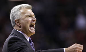 Photo - Kansas State head coach Bruce Weber directs his team against Gonzaga in the second half of an NCAA college basketball game, Saturday, Dec. 15, 2012, in Seattle. Gonzaga won 68-52. (AP Photo/Elaine Thompson)