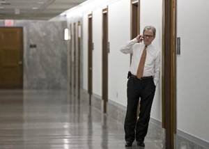 Photo - Sen. Tom Coburn, R-Okla., makes a phone call outside a meeting room in Washington, Wednesday, Sept. 19, 2012. (AP Photo/J. Scott Applewhite)